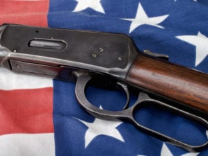 Lever-action rifle and American flag | Top 5 Best Henry Lever Action Rifles For Home Defense and Hunting | featured