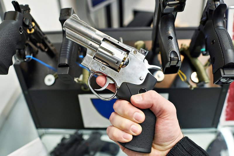 Revolver Dan Wesson in the hand of the buyer in the arms store   glock 19 budget guns
