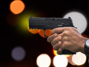 Automatic black 9mm pistol holding in hand aiming | Staccato P Review | Staccato P 1000 Round - The Most Accurate Duty Pistol | Featured