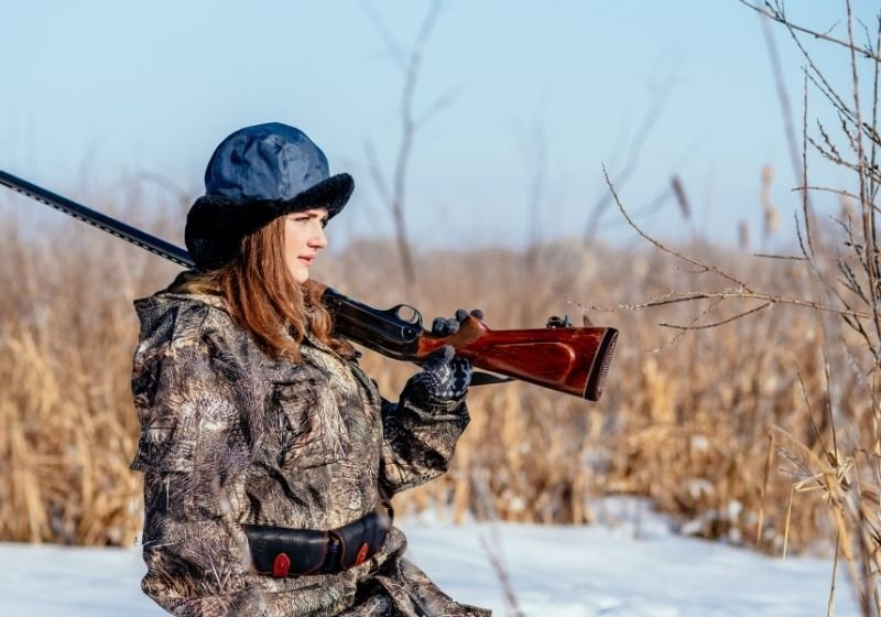 Female hunter in camouflage clothes ready to hunt   6 Best Shotguns for Women   How to Find the Best Shotgun for Women