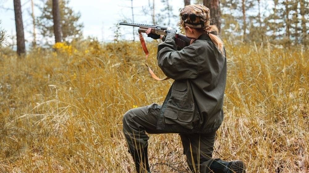Woman hunter in the woods   6 Best Shotguns for Women   How to Find the Best Shotgun for Women   Featured